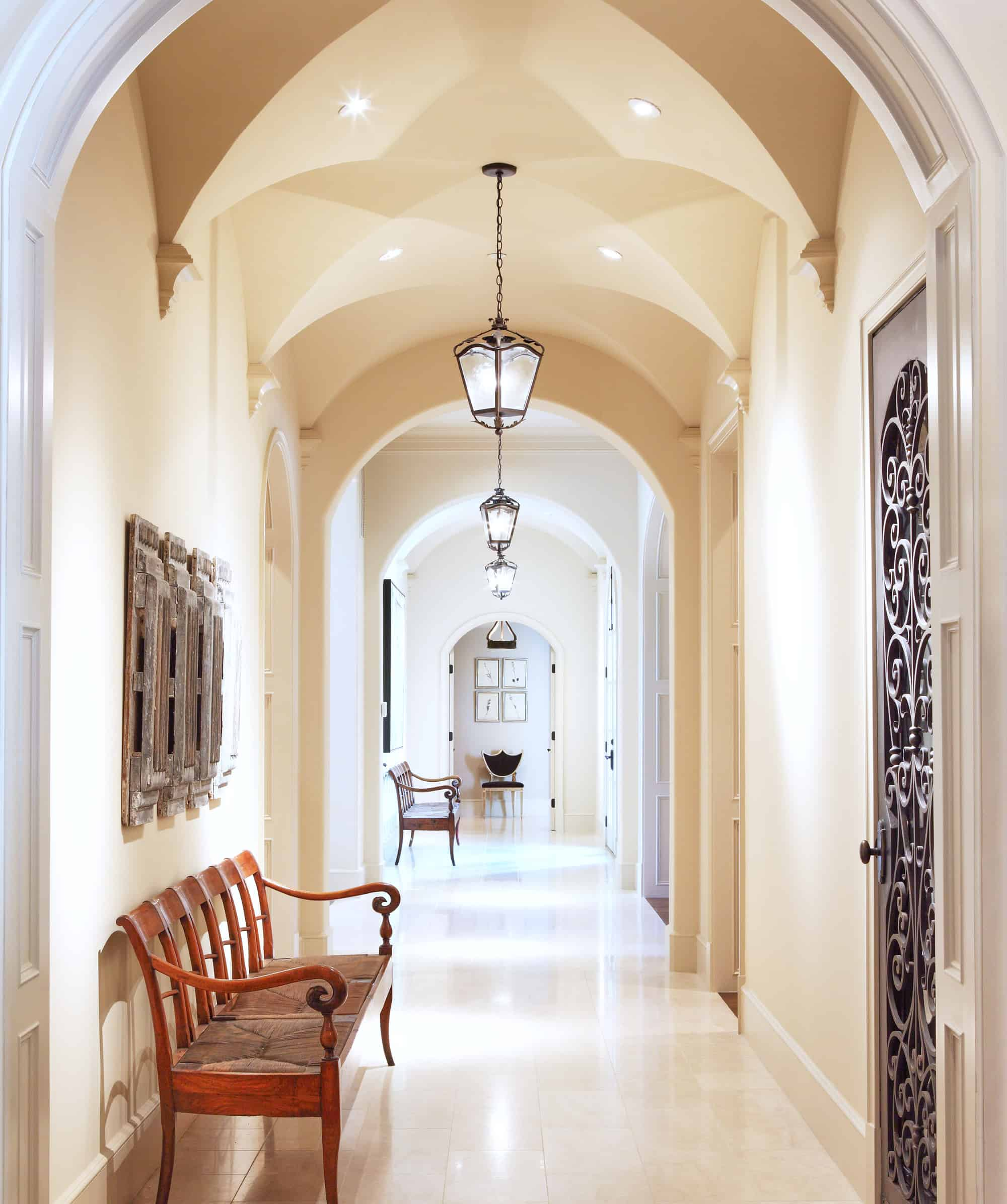 A long hallway with tall ceilings and decorations