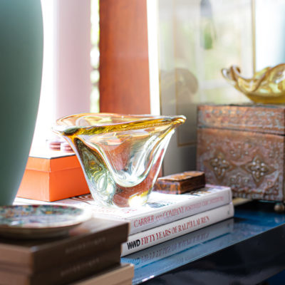 Murano glass bowl on top of design books
